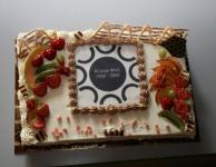 De taart voor de jarige werkgroep
